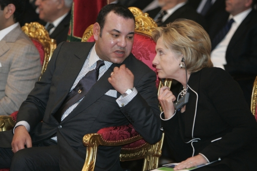 Morocco's King Mohamed VI and U.S. Secretary of State Hillary Clinton, right, speak during the presentation of a solar energy project in Ouarzazate Nov. 2, 2009. (Rafael Marchante/Reuters)