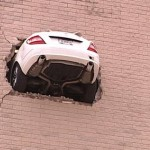 Car Crashes Through Wall Of Tulsa Parking Garage